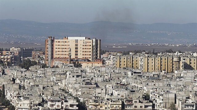 Suicide bombings kill dozens in Syria's Homs