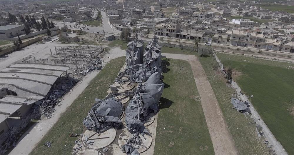 An aerial view shows the damaged cereals silo, located near-by 50 meters to residential area in Khan Shaykhun town of Idlib, after Assad Regime's suspected chemical attack in Idlib, Syria on April 8, 2017.