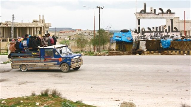 Chemical gas attack survivors leave the town of Khan Shaykun, Idlib province, in a pick-up truck.