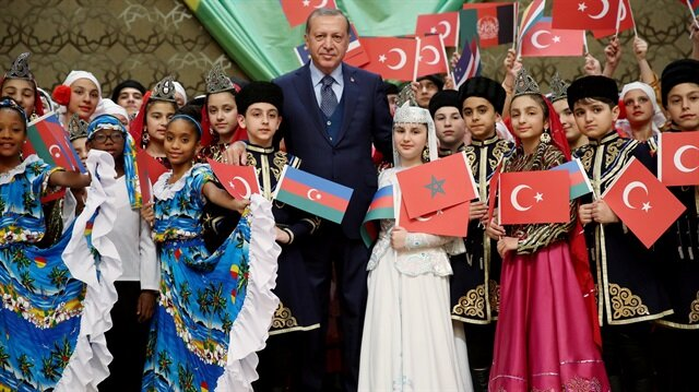 President Tayyip Erdoğan poses with visiting children at the Presidential Palace in Ankara.