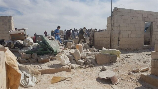 Air attacks kill 6 in refugee camp in Syria's Idlib