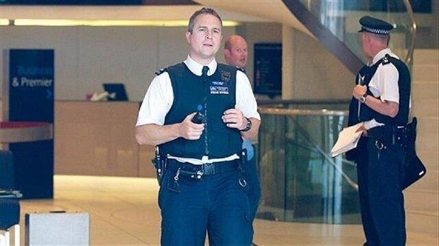 Woman shot, 4 arrested in UK terror raids