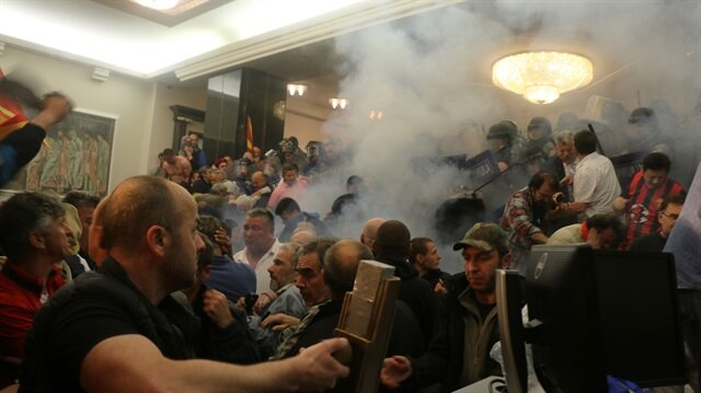 Masked protesters injure MPs in Macedonian parliament