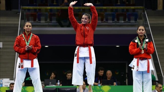 Dilara Bozan (C) of Turkey wins the gold medal in the Women's Karate Kata within the 4th Islamic Solidarity Games at Heydar Aliyev Arena in Baku, Azerbaijan on May 14, 2017.