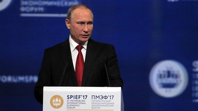 Putin denies U.S. election meddling, says he barely met Mike Flynn