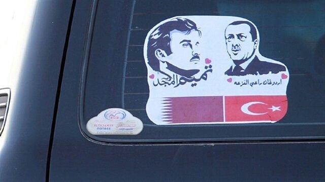 Posters of President Recep Tayyip Erdoğan and Sheikh Tamim bin Hamad al-Thani side by side.