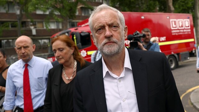 Britain's opposition Labour Party leader Jeremy Corbyn visits the scene of a fire disaster which destroyed a tower block in north Kensington West London Britain