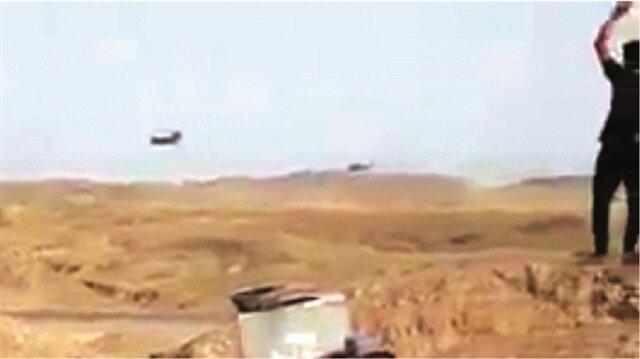 """ABD helikopterlerinin çok alçaktan uçtuğu görülen video kaydı Musul'un güneyinde çekilmiş. Görüntüleri çekenler, kendi aralarında """"DEAŞ'lılar Havice'ye götürülüyor"""" şeklinde konuşuyor."""