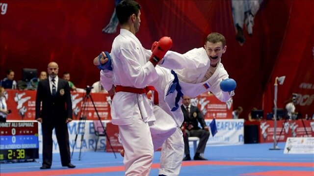Mehmet Ali Sapmaz (L) of Turkey competes against Alexeevich Borovikin (R) of Russia during the Men's 60kg Kumite final match within the 23rd Summer Deaflympics 2017 at Ataturk Sport Stadium in Samsun, Turkey on July 24, 2017.