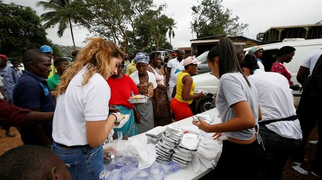 A non-governmental organisation (NGO) is seen distributing meals t