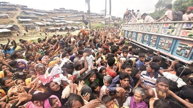 Gathering on the 50 kilometer-long muddy Teknaf road, Rohingya Muslims almost crushed each other trying to catch the clothing and rice bags being thrown from moving trucks.