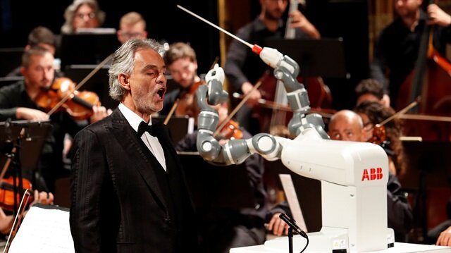 Humanoid robot YuMi conducts the Lucca Philharmonic Orchestra performing a concert