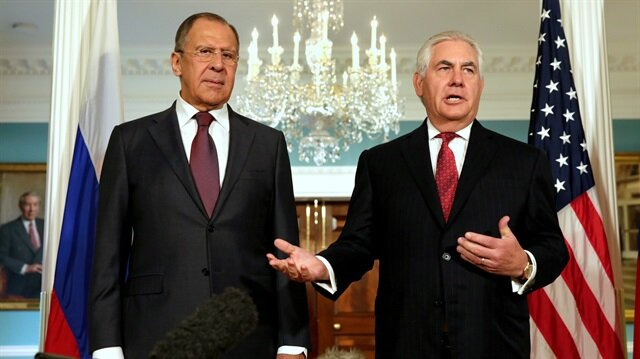 U.S. Secretary of State Rex Tillerson (R) walks with Russian Foreign Minister Sergey Lavrov before their meeting at the State Department in Washington, U.S., May 10, 2017.