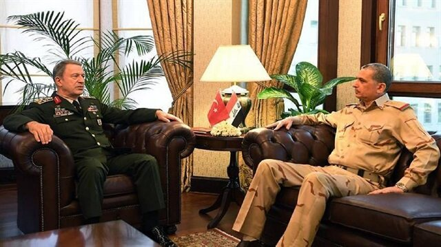 Turkish Chief of General Staff Gen. Hulusi Akar (L) and his Iraqi counterpart Gen. Othman al-Ghanimi