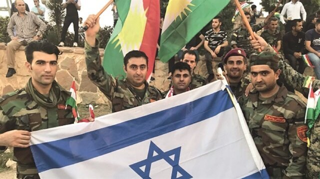 Peshmerga forces were seen waving Israel's national flags in Erbil on Saturday