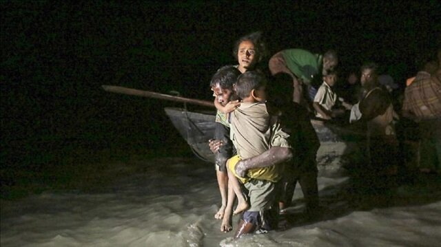 Rohingya people, fled from oppression within ongoing military operations in Myanmar's Rakhine state, cross the border through the water in Shah Pori Island of Bangladesh on September 27, 2017.