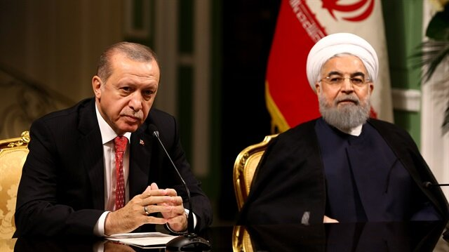 Recep Tayyip Erdogan (L) and Hassan Rouhani (R)
