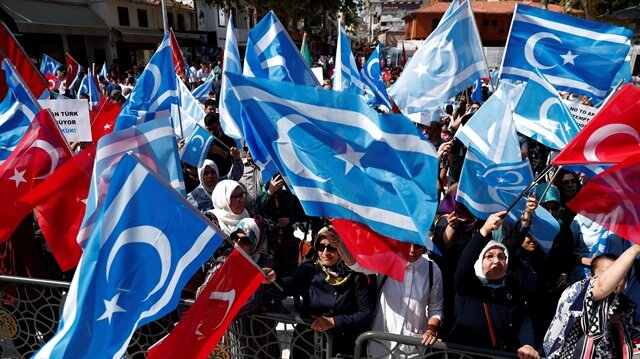 Demonstrators wave Turkish and Iraqi Turkmen (blue) flags during a protest
