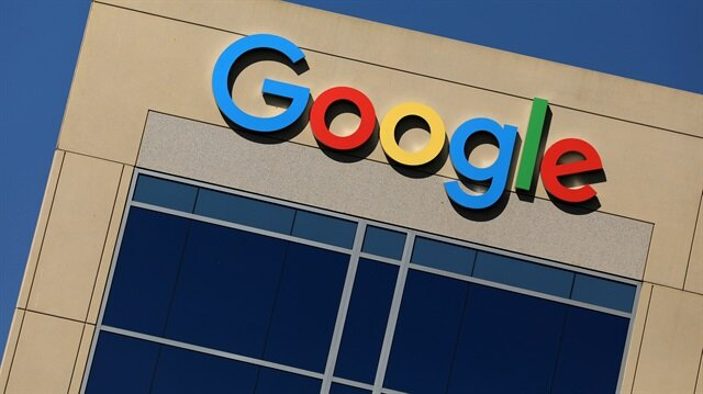 The Google logo is pictured atop an office building in Irvine, California