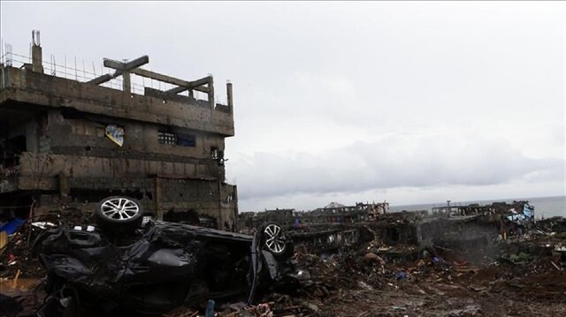 Rebels torch construction equipment in S. Philippines