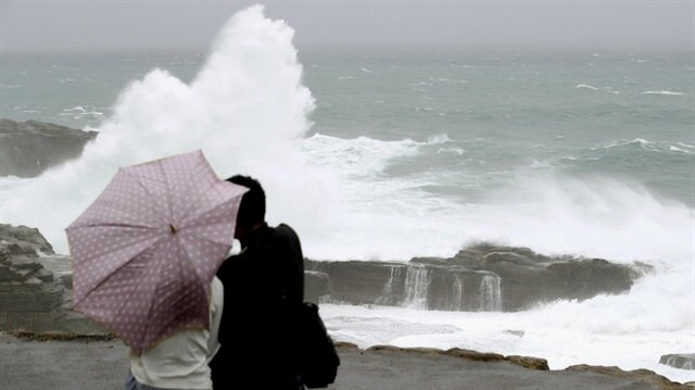 Powerful typhoon drenches Japan, soaks voters as they trudge to polls