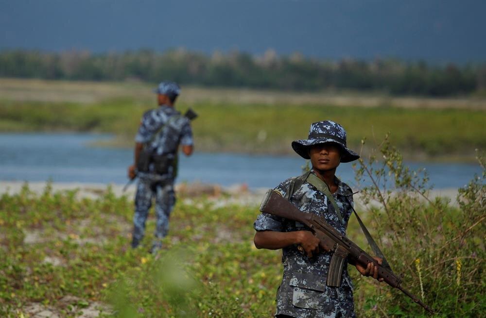 Myanmar border guard police force patrol near the Myanmar-Bangladeshi border outside Maungdaw, northern Rakhine state, Myanmar.