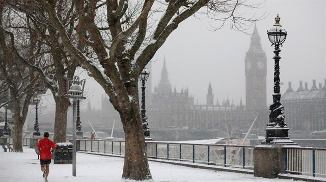 Trains cancelled, flights grounded after snow hits Britain
