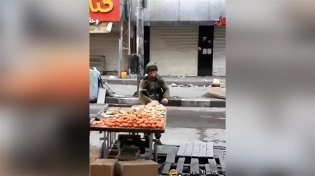 Israeli commander stealing apples caught on video