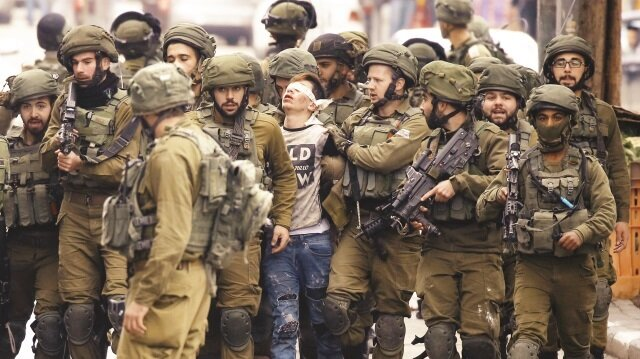 Fawzi al-­‐Juneidi, merely a child who was cruelly bludgeoned by a large number of Israeli soldiers, was repeatedly beaten into the ground and stomped on, following which he was blindfolded and taken first to a military post and then to the Ofer Prison in Israel.