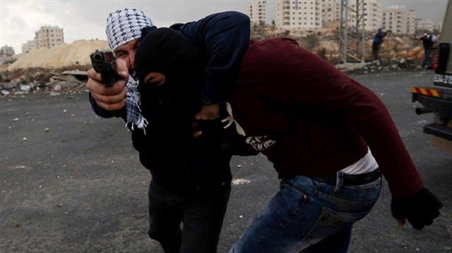 Israeli agents dress up as Palestinians, attack protestors