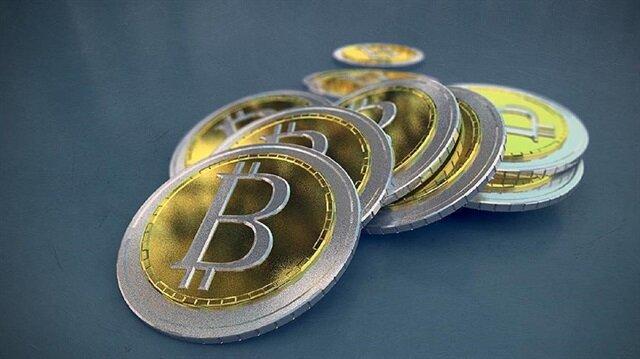 Bitcoin hits new record high as warnings grow