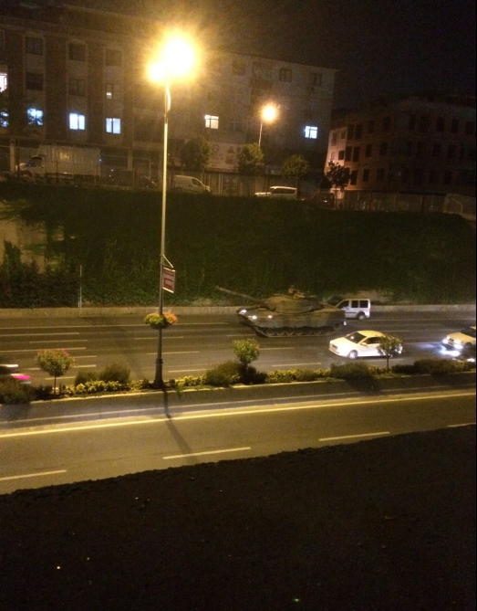 2	Security forces and civilians pulled an earth-mover horizontally to block the tanks on Vatan Avenue from entering the Istanbul Police Headquarters.