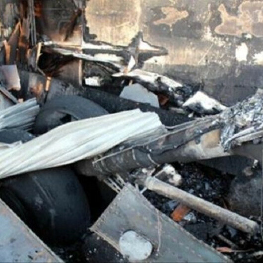Small plane crashes into home, 2 killed