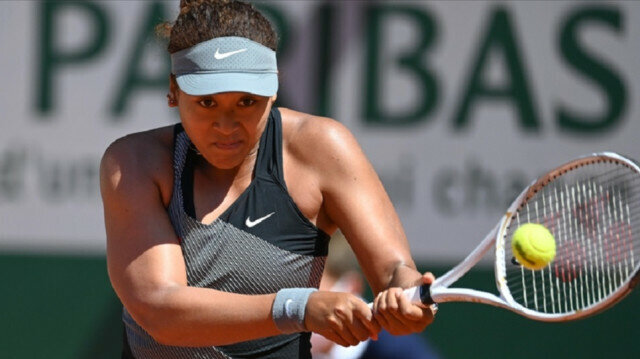 Naomi Osaka of Japan in action against Patricia Maria Tig (not seen) of Romania in the first round of the women singles during the French Open Tennis Tournament at Roland Garros in Paris, France on May 30, 2021. ( Mustafa Yalçın - Anadolu Agency )