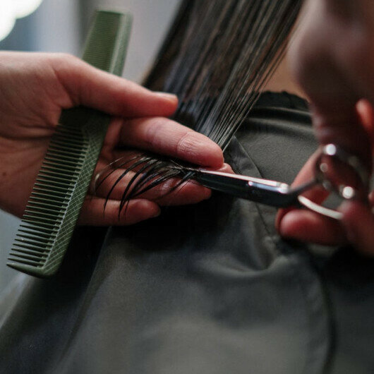 Maasai warriors break taboo, work as hairdressers