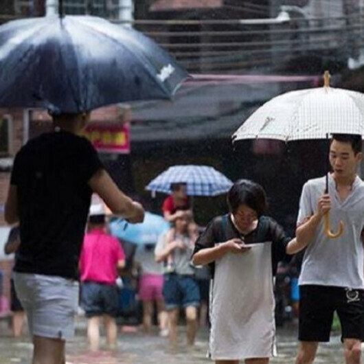 Severe flooding in central China kills 18