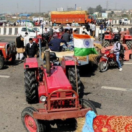 Indian farmers protest near parliament to demand repeal of laws