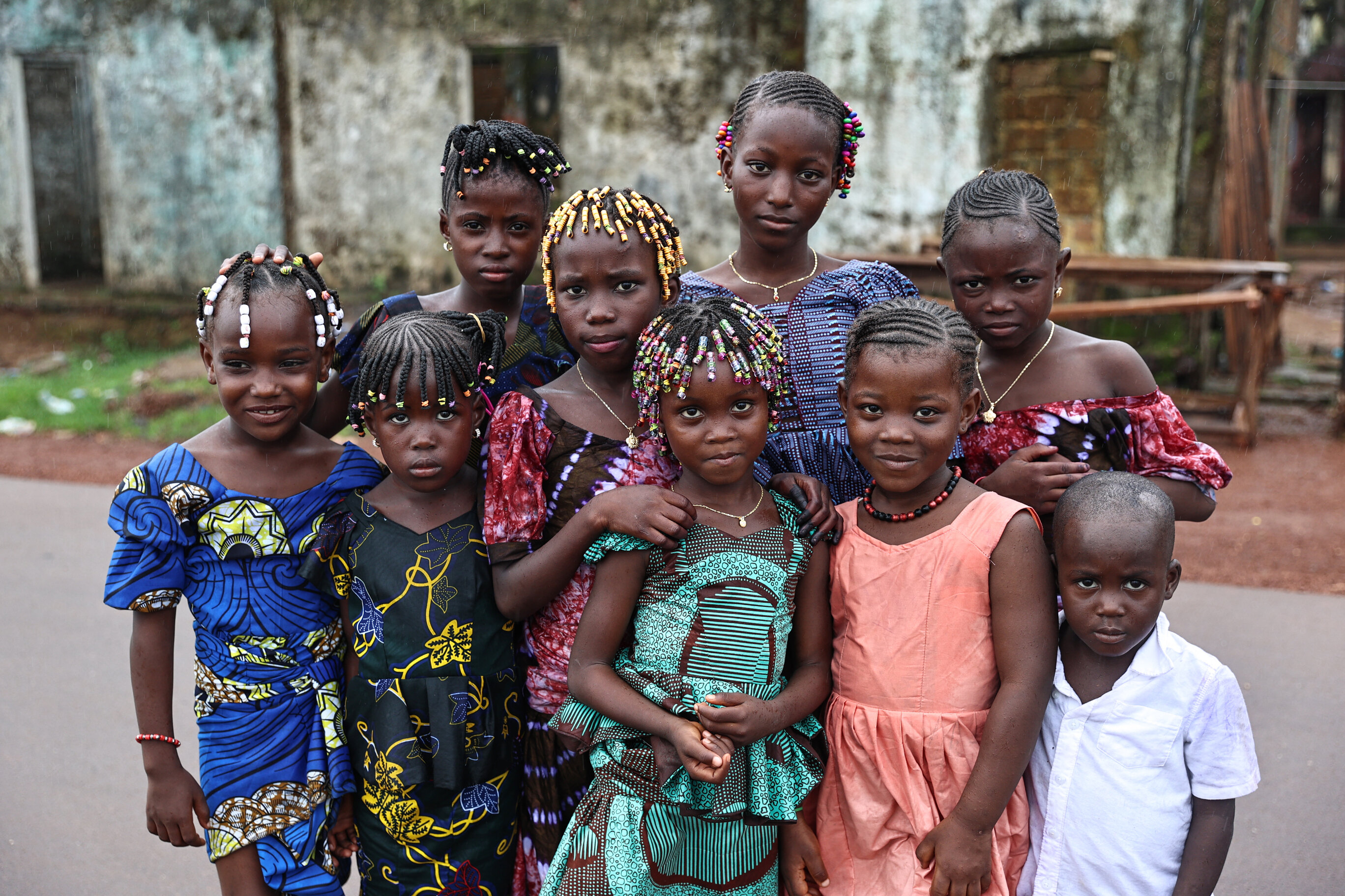 Colorful braids put smiles on kids' faces in Guinea