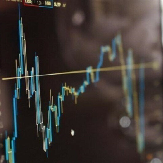 Asian stock markets close day in buoyant mood