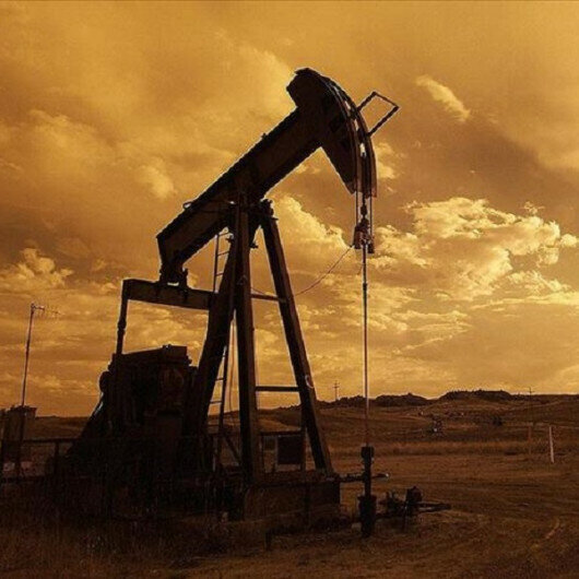 Oil down as strong dollar offsets US supply disruptions