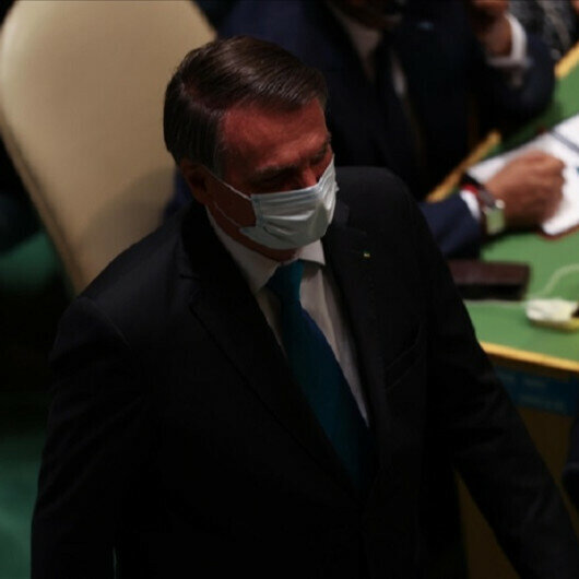 Brazil's president quarantines after member of his delegation catches COVID