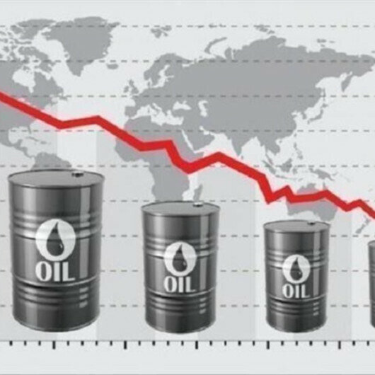 Oil prices down as demand rises due to weaker US dollar