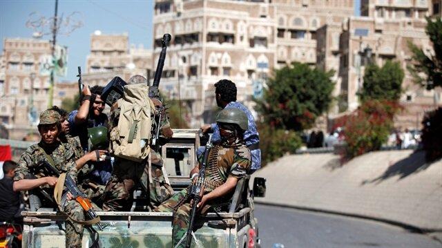 Houthi militants patrol a street in Sanaa