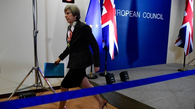 Britain's Prime Minister Theresa May leaves a news conference during the EU Summit