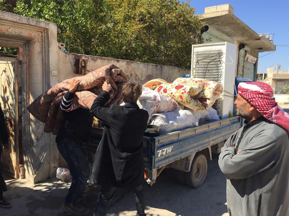 Chemical gas attack survivor residents load their goods on a pick-up truck before leaving the town after yesterday's suspected chlorine gas attack in the town of Khan Shaykun, Idlib province, Syria on April 05, 2017.