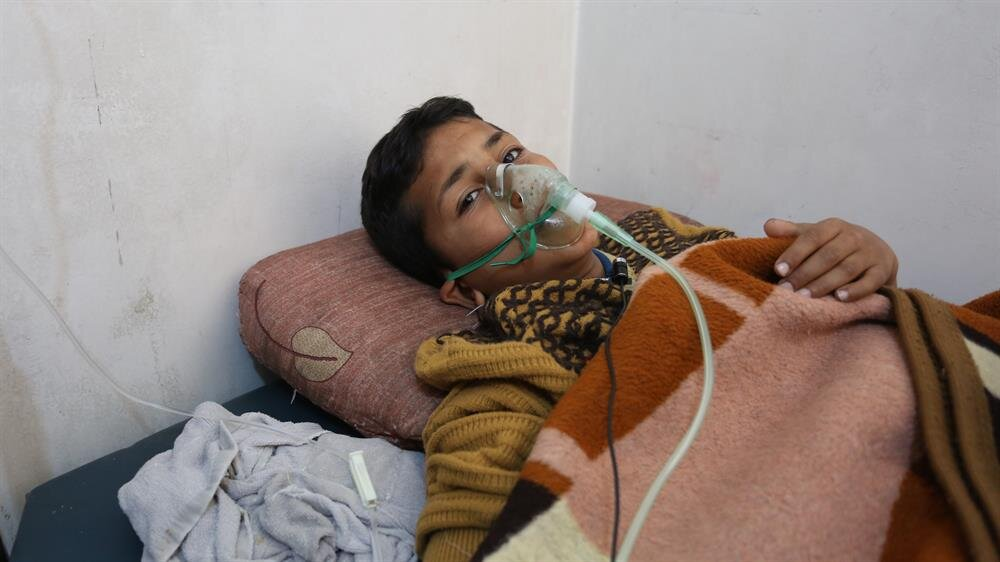 A chemical gas attack survivor receiving medical treatment.