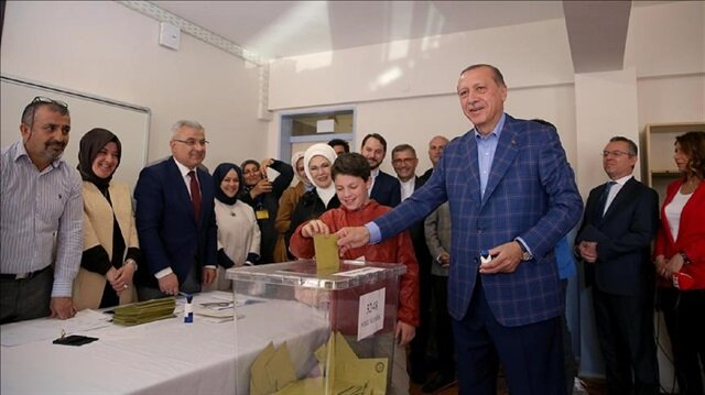 Turkish President Recep Tayyip Erdogan casts his vote with his grandson in the constitutional referendum at a polling station in Uskudar district of Istanbul, Turkey on April 16, 2017.