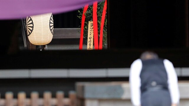 "A wooden sign which reads ""Prime Minister Shinzo Abe"" is seen on a ritual offering, a ""masakaki"" tree, from Abe to the Yasukuni Shrine, inside the main shrine at the controversial shrine for war dead, in Tokyo."