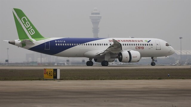 China's home-grown C919 passenger jet lands during its first flight at Pudong