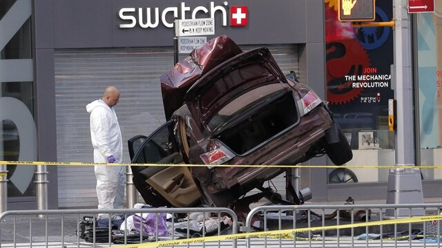 The remains of a vehicle involved in crash are cordoned off in Times Square in New York.